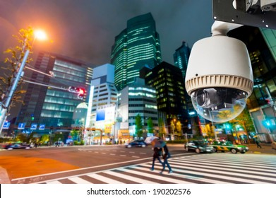 CCTV Camera or surveillance operating on street and building at night
