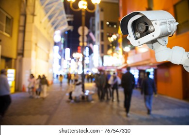 CCTV camera system security in shopping mall supermarket blur background.,Abstract background with Blurred people and shopping center in Dotonbori road in Namba District Osaka - Japan.