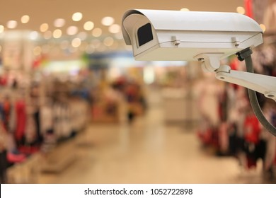 CCTV cameras in shopping malls and have copy space for your design concept of safety in work.