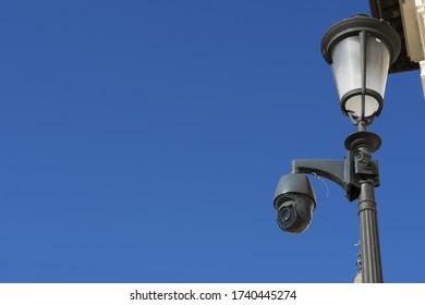CCTV cameras in vintage lamp. A combination of modern and vintage for citizen security