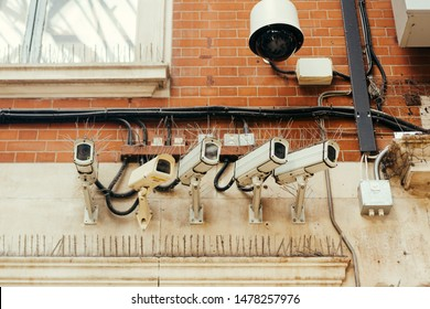 CCTV camers covered with the bird control spikes. Surveillance is used by governments for intelligence gathering, prevention of crime, the protection of a process or the investigation of crime