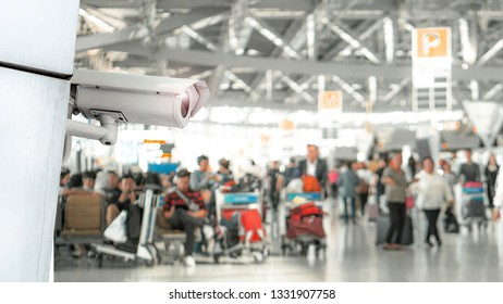 CCTV security camera and airport concept - CCTV surveillance security camera video equipment in terminal airport for safety system area control with copy space