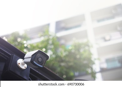cctv security camera with building background - copy space