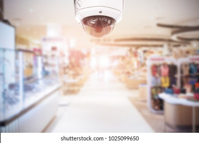 CCTV Security camera department store on blurry background.