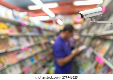 CCTV security camera monitor the Abstract blurred photo of book store with people background