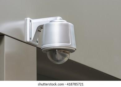 CCTV security camera. Monitoring in London street.
