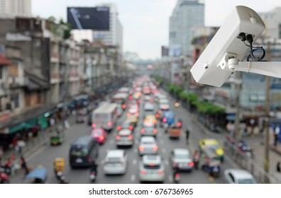 CCTV Security camera monitoring on street, Blurred image of traffic in the city.