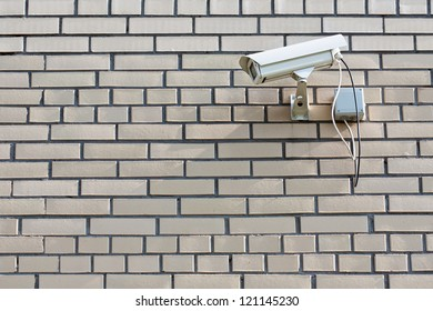 CCTV Security Camera. Security camera mounted on the outdoors brick wall.