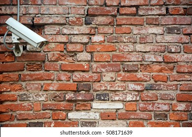 CCTV Security Camera. Security camera mounted on the outdoors brick wall