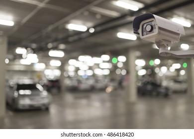 CCTV security camera on blur car parking