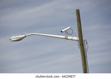 CCTV security camera on pole watching the area