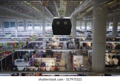 CCTV security camera on the screen blurred abstract Mall.