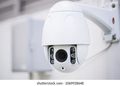 cctv or security camera on wall