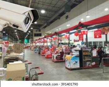 The CCTV Security Camera operating in counter service cashier at supermarket store blur background.