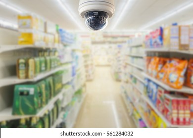 The CCTV Security Camera operating in counter service cashier at supermarket store blur background. Business protection.