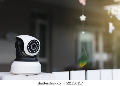 The CCTV security camera operating in home.