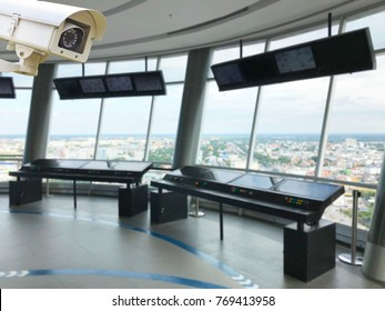 The CCTV Security Camera operating on control tower aviation blur background.