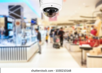 CCTV Security camera shopping department store on blurry background.
