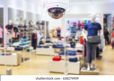 CCTV security camera shopping mall on blurry background.