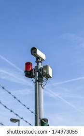 CCTV security camera under blue sky