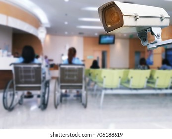 CCTV, security indoor camera system operating with blurred image of patients in a wheelchair waiting in lobby at hospital background, surveillance security technology concept