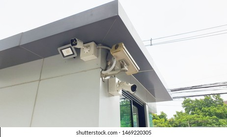 CCTV surveillance camera operating at security guard house to monitor for protection  in front of condominium, apartment, house village,Security equipment concept.