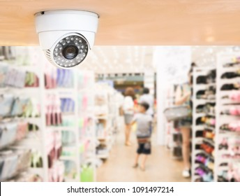 CCTV system security inside of stationery store.Surveillance camera installed on ceiling to monitor for protection customer in grocery shop