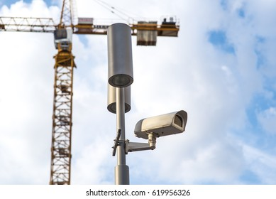 CCTV systems On the sky and construction crane background.