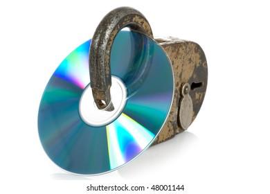 CD discs and padlock on white