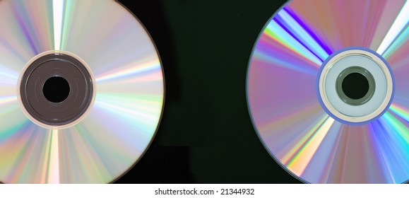 CD and DVD disc on black background