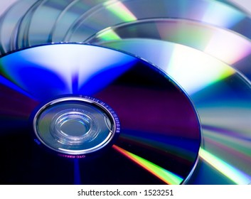 Cd and dvd pile.Virgin disk ready to be written