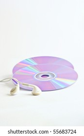 CD and headphone on white background