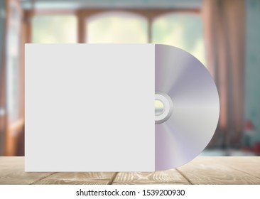 CD on a table with a white cover