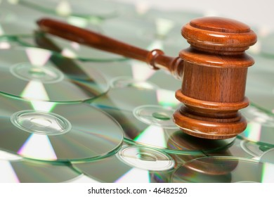 CD Rom or DVD Discs Spread Out and Gavel.