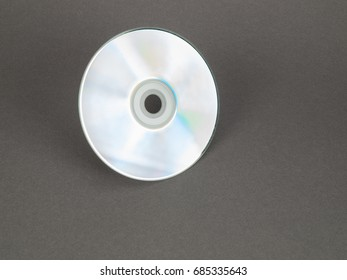 CD/DVD disc, shiny side up, isolated on gray background
