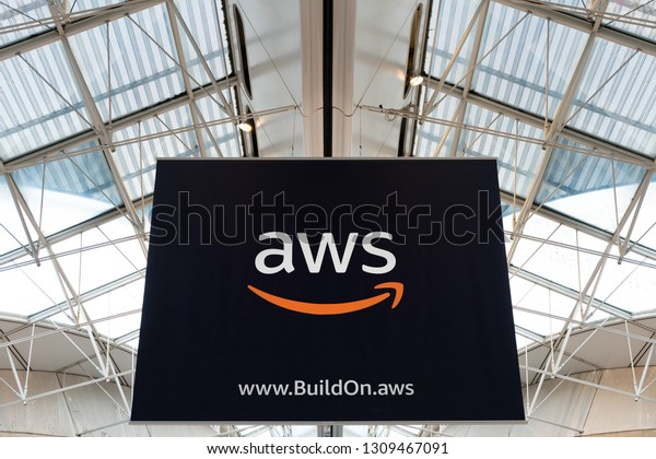 CDG Airport, Paris - 12/22/18: AWS amazon cloud services brand logo at Charles de Gaule Paris airport boarding area, big advertisement. buildon.aws