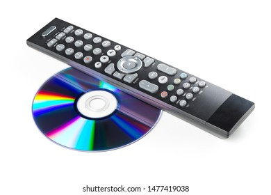 CD-ROM or Blu-Ray disc with tv or disc player remote control on white background. Home theatre movie or series concept.