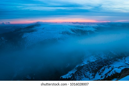 Ceahlau mountain and mystic clouds moving at sunset. Romania