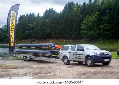 CEAHLAU, ROMANIA - AUGUST 13 2019: truck with canoe for water competition. Ceahlau Water Music Festival in Romania