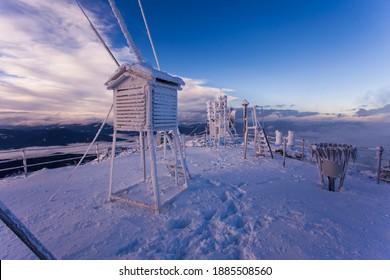Ceahlau Toaca weather station in wintr landscape. mountain scene, Romania