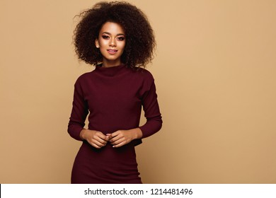 Ceautiful african american woman isolated  on studio background with copy space