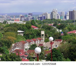CEBU CITY, PHILIPPINES—MARCH 2018: Top distant view of Cebu City skyscrapers and tall buildings seen from Beverly Hills, Cebu.