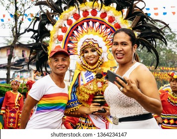 Cebu City , The Philippines - January 20, 2019: Viewers are photographed with a potential Queen of Sinulog. The Sinulog is an annual colorful religious celebration with parade in the Philippines.