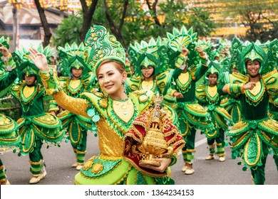 Cebu City , The Philippines - January 20, 2019: Street dancers in vivid colorful costumes participate in the parade at the Sinulog Festival.