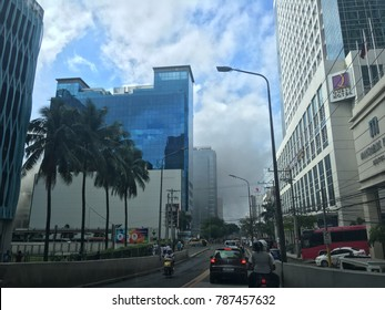 CEBU CITY, PHILIPPINES-JANUARY 6, 2018: Smoke from the burning Ayala Center Cebu mall is visible in the nearby street.