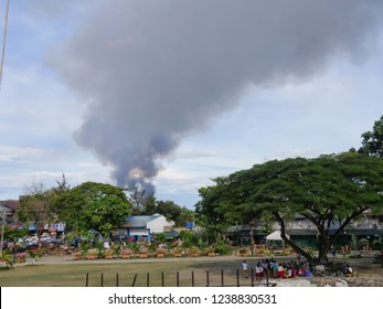 CEBU CITY, PHILIPPINES--MARCH 2018: Heavy smoke rises up in the air as fire razes hundreds of residential structures in Mandaue City.