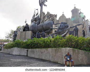 CEBU CITY, PHILIPPINES--MARCH 2018:  A man sits outside the Heritage of Cebu Monuments, one of the top tourist attraction in Cebu City.