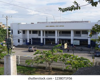 CEBU CITY, PHILIPPINES--MARCH 2018: Wide shot of the façade of the Cebu Central Post Office, with power lines criss-crossing in the foreground.