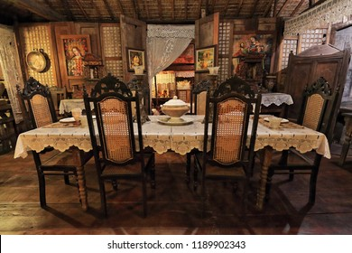 Cebu City, Philippines-October 18, 2016: Balay nga bato-Bahay na bato-stone house is a type of building from the Spanish colonial era. Dining room-table and set of 6 wooden chairs-tureen on tablecloth