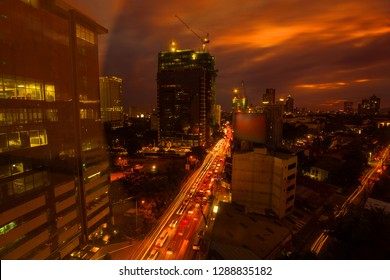Cebu City urban night photography with car light trails in a sunset dusk